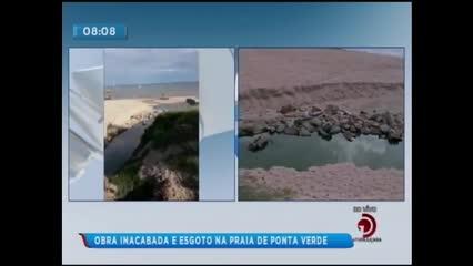 Obra inacabada e esgoto na praia de Ponta Verde